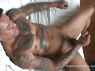 Tattooed Poofter Enjoys Playing With His Prick Indoors